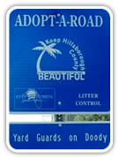Yard Guards On Doody Adopt-A-Road Sign